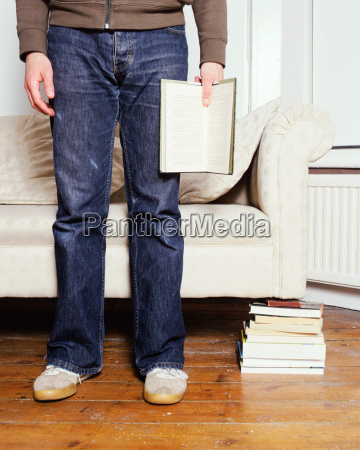a young man holding a book