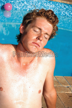 young man sunbathing
