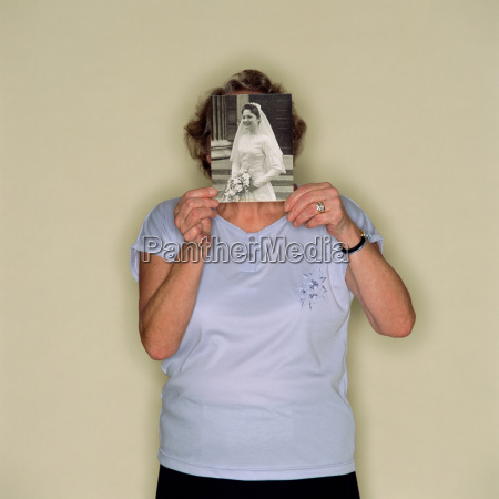senior woman holding a photo of