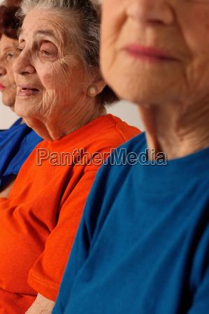 three elderly women partial view