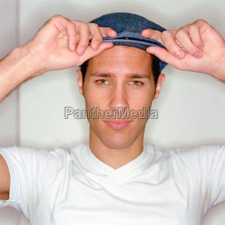 young man wearing a cap