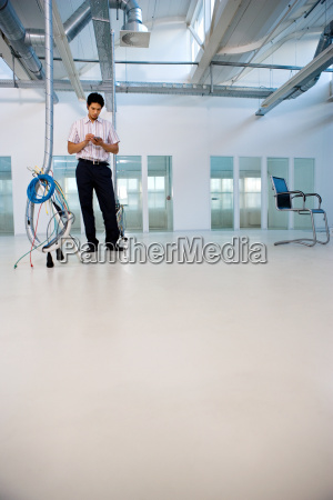 man standing in sparse office