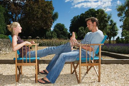 man massaging his girlfriends feet