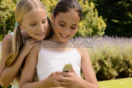 two girls with mobile phone
