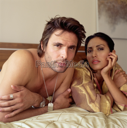 sexy couple lying on a bed