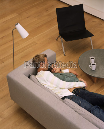 couple lying on the sofa