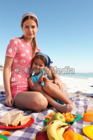 mum and daughter having a picnic