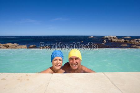 mature couple in swimming caps