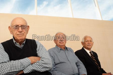 portrait of three elderly men seated