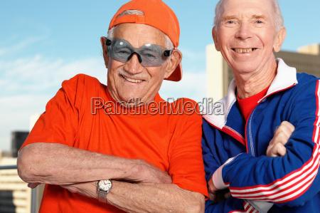 portrait of two smiling elderly men