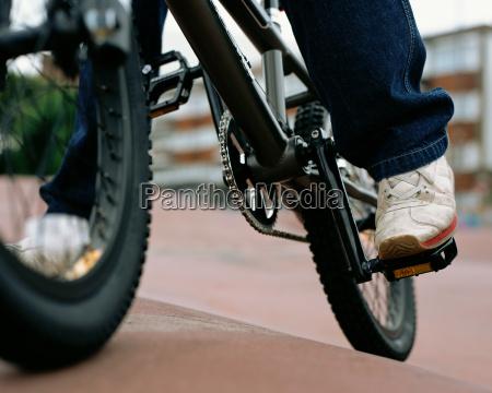 boy riding a bmx bicycle