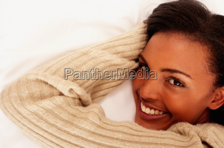 smiling young woman lying down