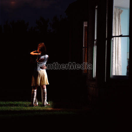 couple hugging outside house