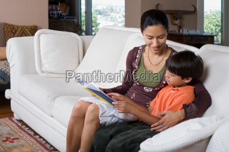 woman and boy reading