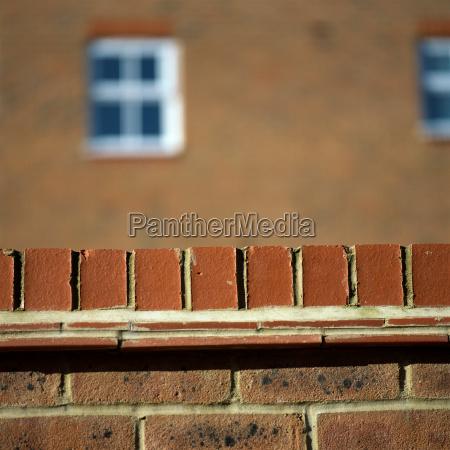 brick wall near house