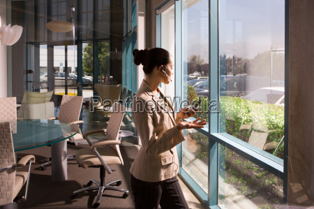 businesswoman on cell phone in meeting