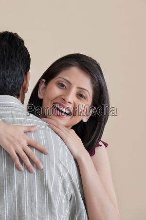 portrait of woman hugging her husband