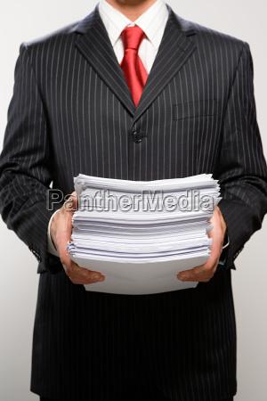 businessman holding paperwork