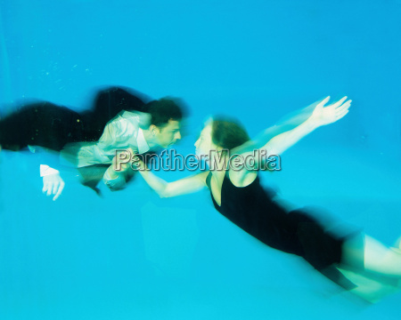 a couple dancing in a swimming