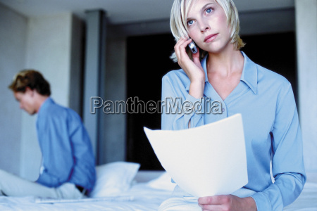 man and woman working from bedroom