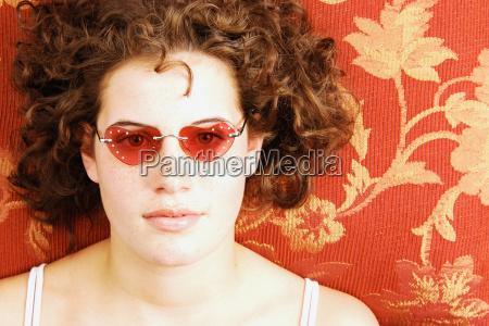 woman wearing heart shaped sunglasses