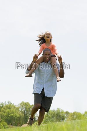 man carrying daughter