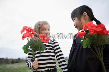 girls holding flowers