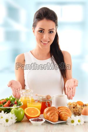 young woman having breakfast balanced diet