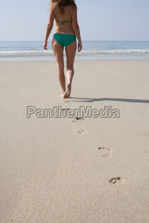 woman walking on a sandy beach