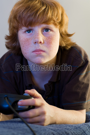 a boy playing a video game