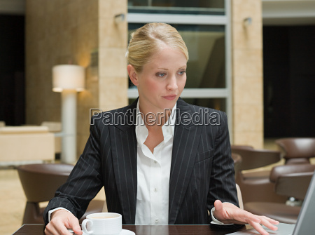a businesswoman using a laptop