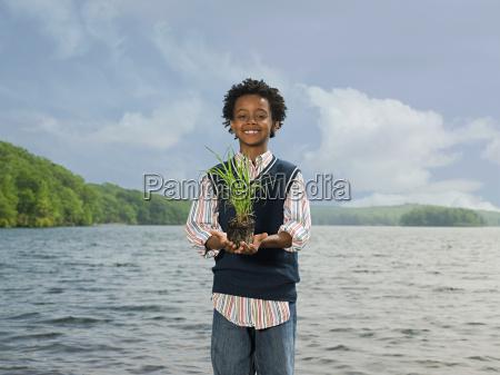 a boy holding grass