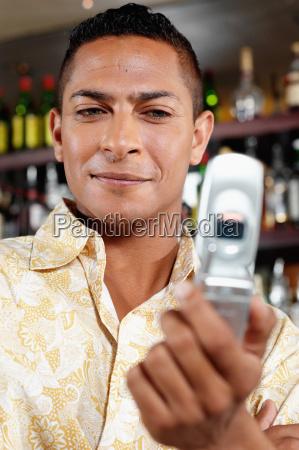 man holding cellular telephone