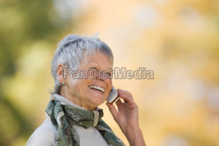 smiling senior woman using a cell