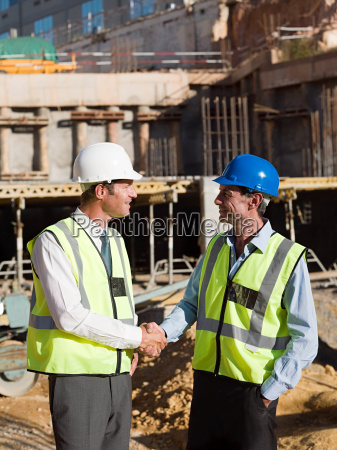 mature men meeting on construction site
