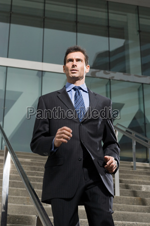 a business man running down a
