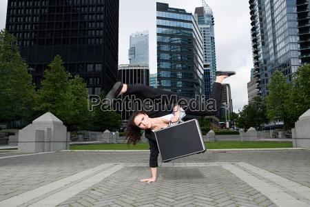 businesswoman practising capoeira