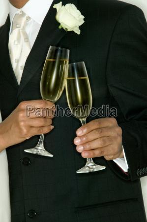 newlywed couple toasting