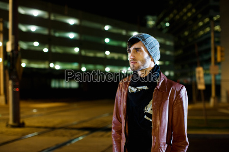 man in city at night
