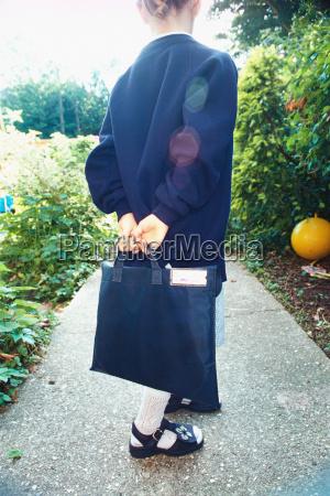 girl wearing a school uniform