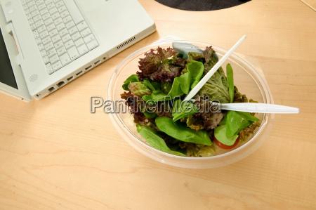 bowl of salad on a desk