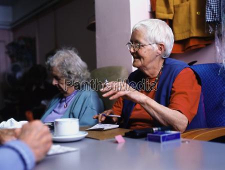 women smoking and playing bingo