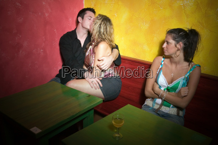 jealous woman watching couple