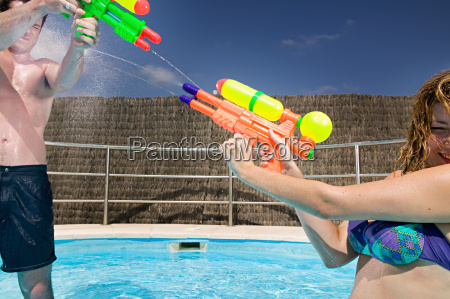 people playing with water pistols