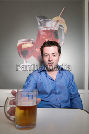 man reaching for beer glass