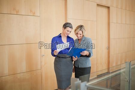 businesswomen looking at paperwork