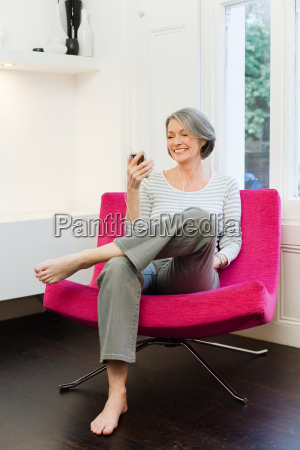 mature woman listening to mp3 player