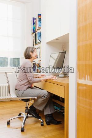 mature woman using a computer