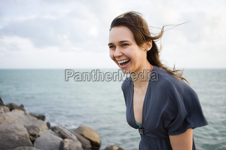 happy young woman by the sea