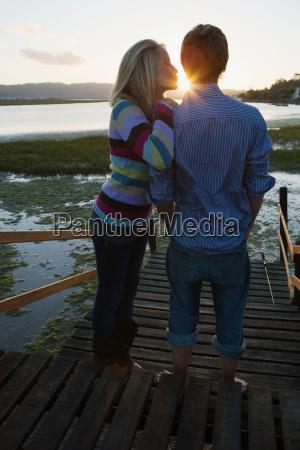 teenage couple at sunset
